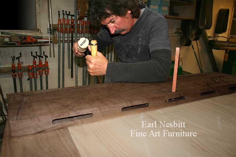 Earl pegs tenon at one end of a custom made dining table showing mortises