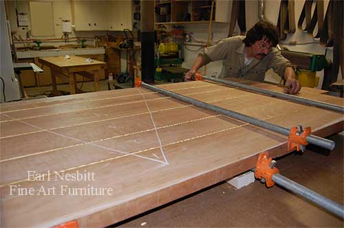 Earl glues up boards for a custom made cherry dining table