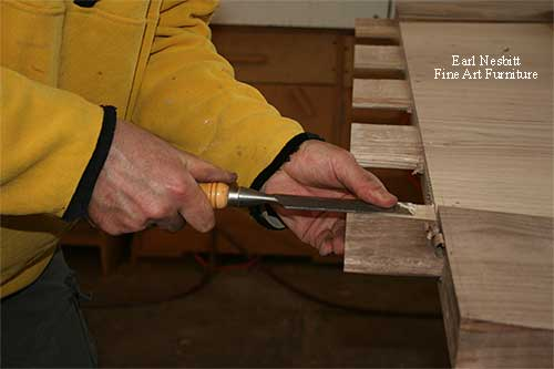 Earl chiseling tenons on one end of custom made dining table