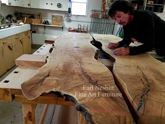 Earl draws notched edge on mesquite slabs for glass for a custom made live edge dining table with eight chairs