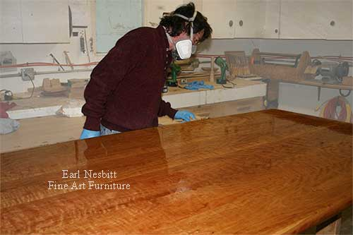 Earl oils a custom made cherry dining table