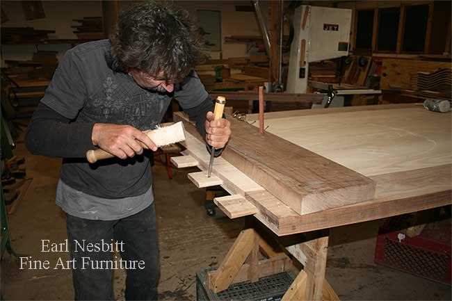 Earl pegs tenon of a custom made dining table from the other side