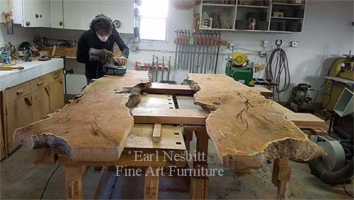 Earl rough sanding mesquite slabs for custom made live edge dining table