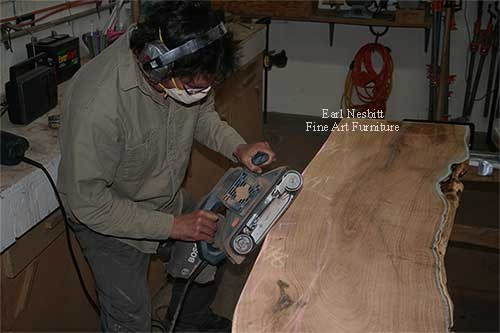 Earl sculpting mesquite slabs for custom made live edge dining table