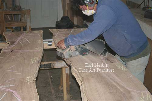 Earl leveling mesquite slabs for a custom made live edge dining table
