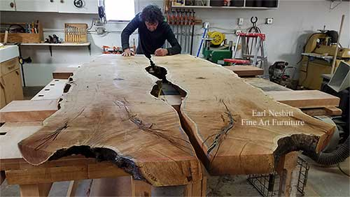 Earl drawing notch for glass on mesquite slabs for a custom made live edge dining table