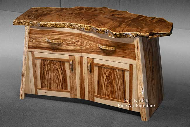 custom made cabinet showing red mulberry live edge slab top