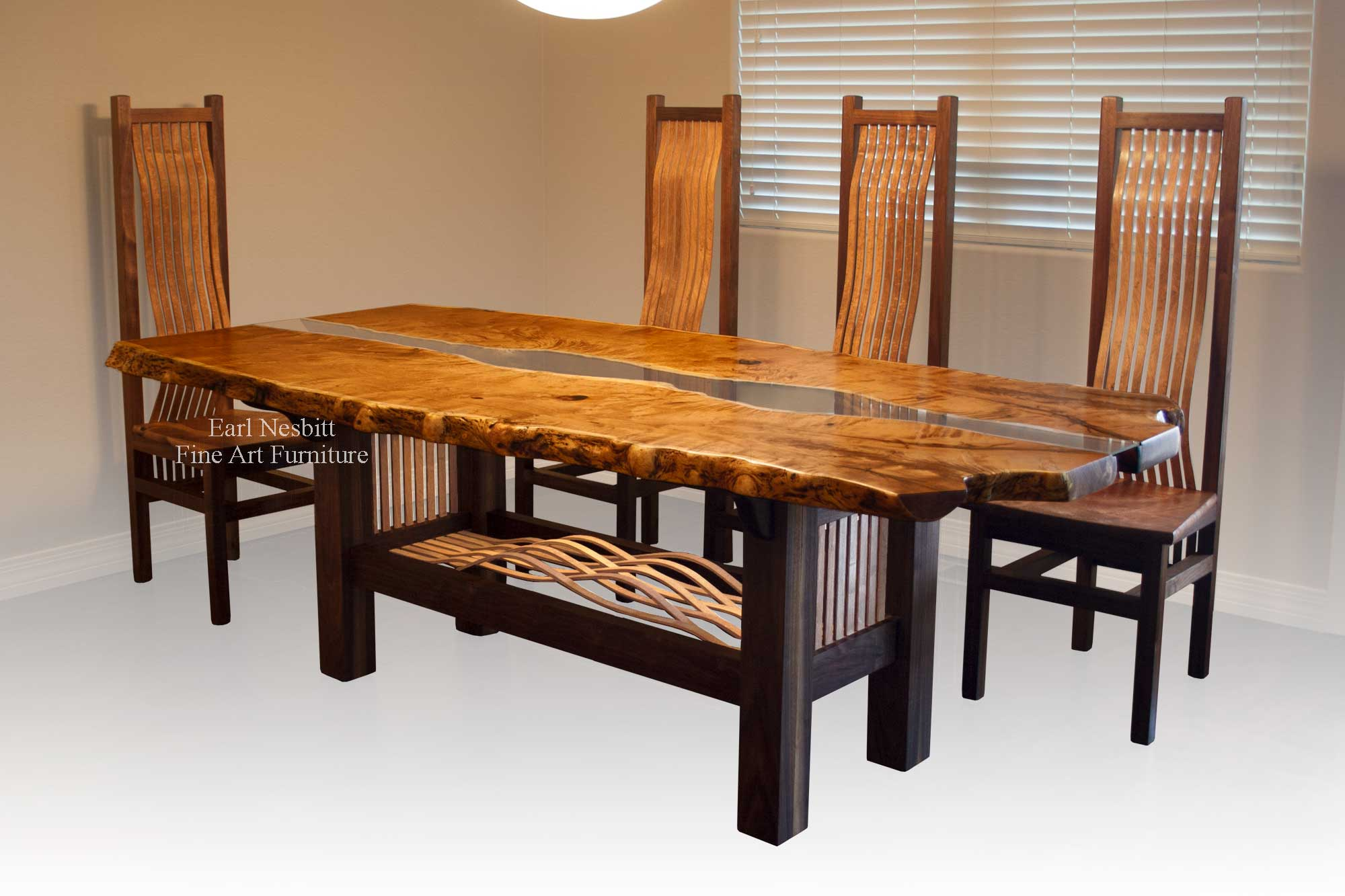 custom made live edge dining table showing four of eight chairs