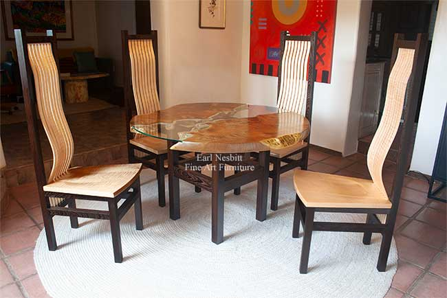 the set of four custom made dining chairs around the matching round live edge dining table