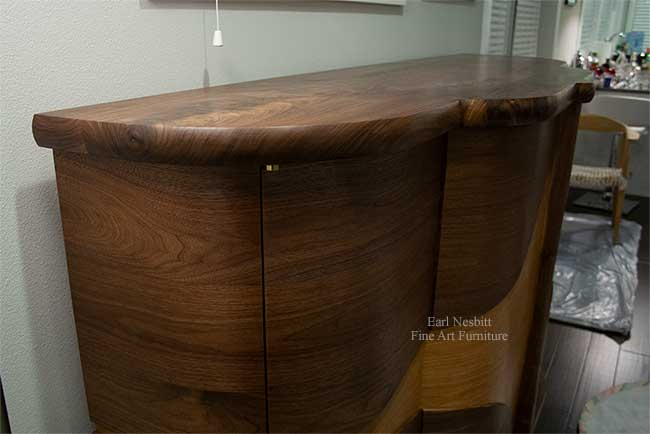 art deco bar cabinet from slightly above emphasizing curved design