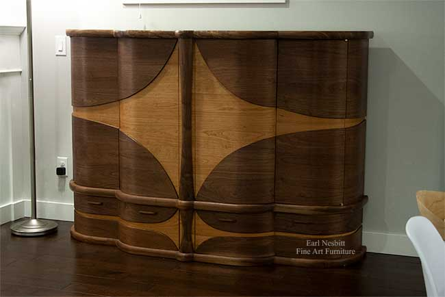 art deco bar cabinet emphasizing curved design from other side with all doors and drawers closed