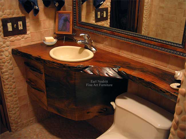 live edge bathroom vanity showing one end of solid mesquite slab