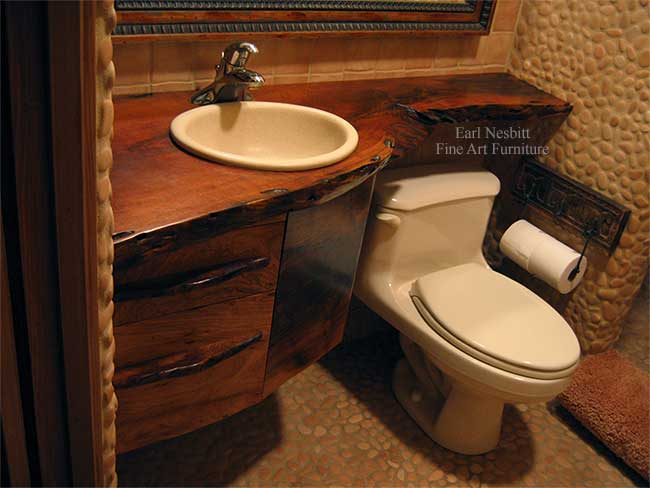 live edge bathroom vanity showing other end of mesquite slab