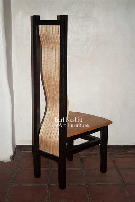 custom made comfortable dining chair showing curve of curly maple bent laminate slats