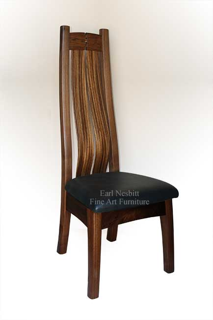 custom made dining chair showing cushioned black leather seat