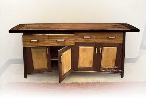 custom made contemporary cabinet showing walnut top with one drawer and one door open