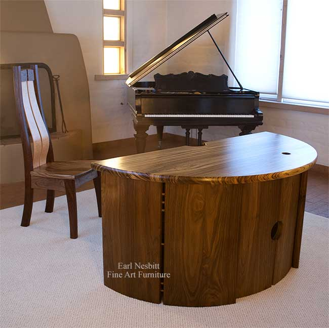 custom made executive desk with matching chair showing zebrawood top and walnut base
