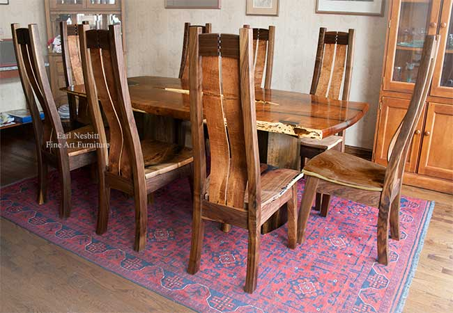 live edge mesquite table showing all eight custom made chairs