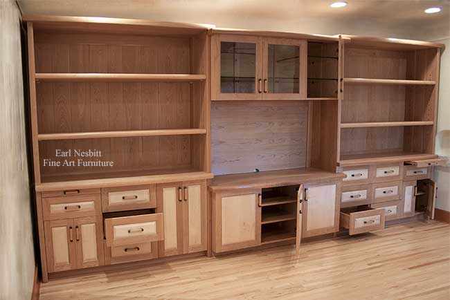 custom made cabinets with some doors and drawers open